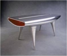 Event horizon table by Marc Newson was inspired by a surfboard, made in the same body shop as old Aston Martins