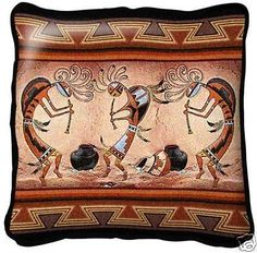 """Kokopelli Pot Dance Tapestry Pillow"" This whimsical Southwest design features three kokopelli dancers. The colors in this woven pillow are sure to add warmth to any Southwest style decor. This pillow"