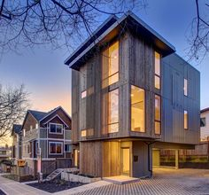 Seattle-based architectural firm First Lamp Architecture has created the Ballard Aperture House in Seattle, WA