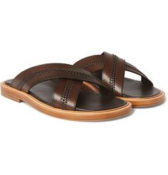 A pair of leather sandals is the last word in summer style, and this design from Gucci has an air of luxury that's too good to reserve just for the pool. They've been crafted in Italy from dark-brown hide and feature woven detailing which adds a stylish point of difference. Wear them with tailored shorts and a softly structured blazer during long lunches on the piazza.