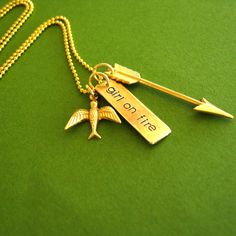 Hunger Games Necklace - Girl on Fire - Mockingjay and Arrow in brass... ($26) ❤ liked on Polyvore featuring jewelry, necklaces, chain jewelry, gold plated jewellery, gold plated jewelry, brass chain necklace and initial necklace