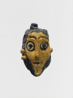 Glass head pendant (made in Phoenicia,CYprus as well as at Carthage)phoenician,650-550 b.C