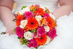 My bouquet from my wedding (all fresh flowers): pink roses, orange gerbera daisies, ivory roses, green hypericum berries, and silver glitter sticks bridal bouquet. Very bright and beautiful.