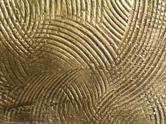 brushed gold texture.  http://mayang.com/textures/Metal/images/Patterned%20Metal/brushed_gold_050549.JPG