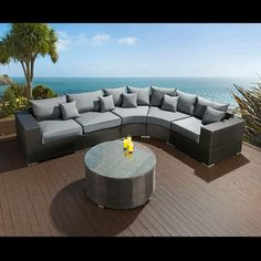 Huge luxury outdoor garden 7 seater corner sofa group black rattan 3. Truly stunning in design, this large 7 seater corner sofa gives a super high-class feel. This set consists of left and right hand end pieces, 1 x middle sofa piece, 2 x large rounded corner pieces, large coffee table, clips to hold them all together, 5 x scatter cushions and a heavy-duty cover in green. Call 02476 642139 or email sales@quatropi.com or visit www.quatropi.com for additional information.