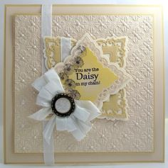 John Next Door Spellbinders Labels 42 Labels 42 Decorative Accents, CE Clear stamps Daisy Corner Elements set, Sand and Khaki Foundation card, White seam binding, Cosmic shimmer pearl PVA & Dazzler settings.