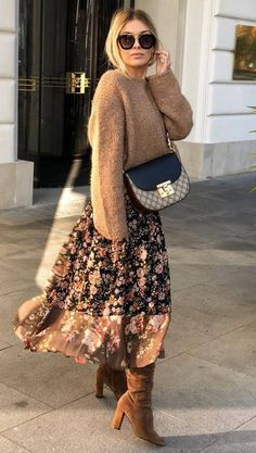 Not a big fan of the boots or bag but love the layered look of the skirt and sweater. Also the tones.