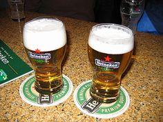 Heineken - Two glasses of Heineken beer.