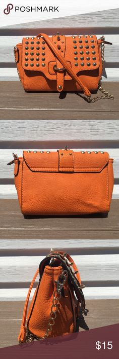 Orange crossbody/clutch purse by Urban Expressions Gold hardware studded crossbody purse. Straps are removeable (but not adjustable) to convert purse to an evening clutch. Has 1 zippered inside pocket and 2 open pockets. Measurements: 10in D x 8.5 in L x 3 in W x 6in H. Condition: great/like new. Urban Expressions Bags Crossbody Bags