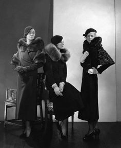 1932    Models are wearing from the left:    a wool coat with a fur collar and armbands;    a wool coat with a blue fox collar by Jeanne Lanvin;    and a wool coat with a caracal collar and sleeve trimming by Mainbocher.