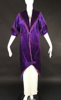 Amazing and rare couture piece from the Maison Doucet dating to c.1912. The coat is a pane velvet in a gorgeous royal purple and lined in a cobalt blue silk. Spread collar with points in back. Short,