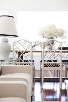 I love the pattern on the chair cushions! And so much white! Even the hydrangeas are white! Definitely keeps the room feeling fresh!