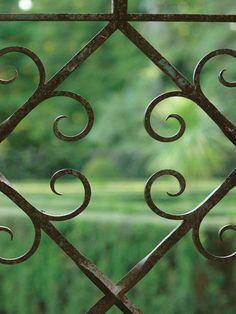 Filigree detail of the maze gate crafted by a local artisan. Neil A. Landino Jr.  - Veranda.com