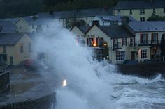 Large waves crash against the harbour wall in Dunmore East, Waterford, this evening [Oct 17, 2012]. Image Michael Whelan