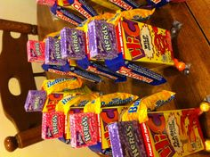 I just used hot glue to attach them! So easy and cheap 10 for a giant multi bag of candy  and 5 for 2 ten packs of juice boxes Something different for school birthday treat!!!
