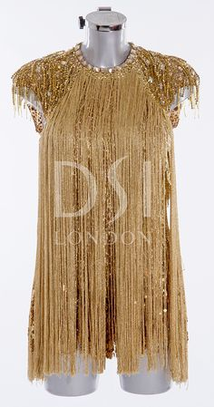 As worn by Caroline Flack on Strictly Come Dancing 2014. Designed by Vicky Gill and produced by DSI London