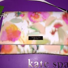 """Kate Spade Sally Kate Spade Sally Grant Street Grainy Vinyl  Giverny Floral Retail Price:  $125.00 14k Gold Plated Accents Magnetic Snap Closure Interior Slide Pocket Cream Kate Spade New York Interior Measures 5"""" H x 2"""" D x 7.5"""" L 22"""" strap kate spade Bags"""