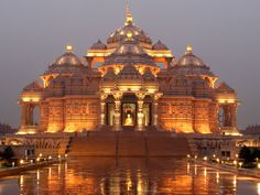 Largest Hindu temple in the world: Delhi Akshardham, Noida Mor, New Delhi, India. The central feature of the complex is the ornately hand-carved stone temple, or mandir. Built according to ancient Vedic texts, and measuring 356 ft (109 m) long, 316 ft (96 m) wide and 141 ft (43 m) high, it is the world's largest comprehensive Hindu temple. It was built within five years by 11,000 artisans and volunteers of BAPS Swaminarayan Sanstha, an international socio-religious organization.