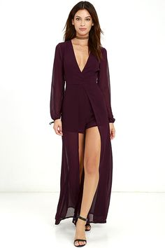 Take a twirl in the Gone With the Whirlwind Plum Purple Romper for a trend that's the best of both worlds! Woven poly sweeps across a surplice bodice with princess seams, and long sleeves with tying cuffs. Sheer maxi skirt, with front slit, tops fluttering shorts for a head-turning finish. Back keyhole with top button closure. Hidden back zipper.