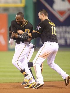 CELEBRATE GOOD TIMES: Baseball's Walk-Off Wins -      June 12: Pittsburgh Pirates third baseman Josh Harrison (hidden) and shortstop Jordy Mercer (10) celebrate with left fielder Starling Marte (middle) after Marte drove in the game winning run against the Philadelphia Phillies during the thirteenth inning at PNC Park. The Pirates won 1-0 in thirteen innings. - © Charles LeClaire, USA TODAY Sports