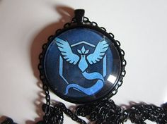 Handmade Jewelry Pokemon Go Pokemon Team Mystic Game Symbol Round Glass Pendant Necklace with Matching Chain ** You can find out more details at the link of the image. Mystic Games, Pokemon Team, Couples Coupons, Band Tees, Glass Pendants, Diy Fashion, Pocket Watch, Round Glass, Money Order