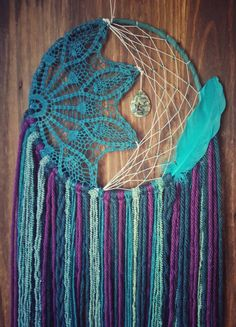 Calling all mermaids! ✊  This mermaid inspired dreamcatcher is gorgeous! It is a 10in hoop webbed in glass beading and a half teal doily. It is adorned with a beautiful stone and feather,and is 30-34inches in length. It is sure to make a statement in any room.  If you need more than one piece, just message me! **Made To Order** All solid fabrics and doilies are hand dyed and may slightly differ from pic shown.  BE INSPIRED See a style you want but need different colors? Message me!   Come…