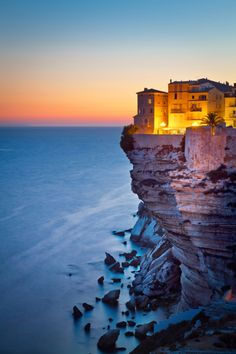 Photo about Twilight on the beautiful cliffs and buildings of Bonifacio, Corsica Island, France. Beautiful Places In The World, Places Around The World, Oh The Places You'll Go, Travel Around The World, Wonderful Places, Great Places, Places To Travel, Places To Visit, Around The Worlds