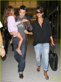 Halle Berry and Oliver Martinez depart a flight at LAX Airport with her daughter Nahla on July 9, 2013