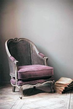 vintage wicker & velvet, purple chair. Old yet elegant. Would look great in a rustic setting