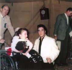 Elvis - September 27th '57 (eBay) Tupelo Candid!  |  Two girls, one on crutches and the other in a wheelchair, were brought into the tent to meet Elvis. Twelve-year-old Ann Hill of Ashland had been born with a type of infantile paralysis, and Shirley Martin, 14, of Dorsey, had been crippled for three years. Elvis talked with each and hugged them both.
