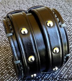 Black double buckle studded bracelet. Made of real leather this bracelet combines both style with comfort. The leather cuff is 2.5 wide.
