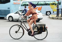 Catherine Baba during Fashion Week in her signature bike and head wrap. Shot by Tommy Ton for Style.com