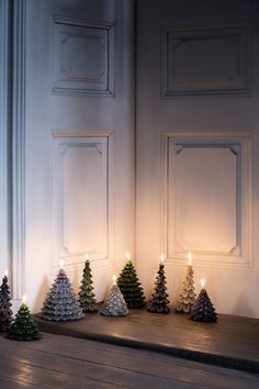 Evergreen tree candles cast a glow
