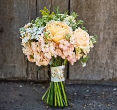 Peach bouquet: roses, stock, thistle and queen Anne's lace --- is it possible to do this in light purple?!