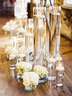 Varying size glass vases for a wedding table setting