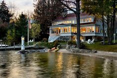 This home was built on Lake Winnipesaukke in New Hampshire.   TMS architects created a home that respected the Lake's historic past.  The details in this house are quite cottage....but it's a large home. from Mod Vintage Life: Open House Sunday