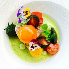 Raw egg and basil crusted tomato