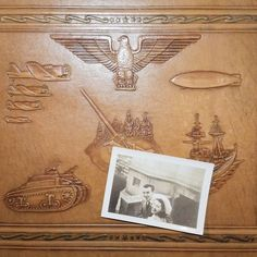 1943 embossed leather photo album and snapshot of the young lady who owned it #wwii #photoalbum #wartime #sweethearts #1943 #embossed #militaria #vintagephotos #tank #zeppelin #eagle