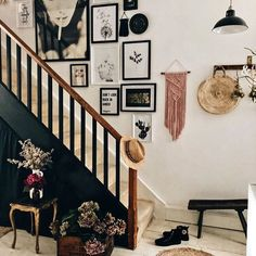 A gorgeous entrance way if ever I did see one. Love the dark staircase, pink macrame hanging and gallery wall Gallery Wall Staircase, Staircase Wall Decor, Staircase Runner, Staircase Design, Dark Staircase, House Staircase, Stair Design, Staircase Ideas, Gallery Walls