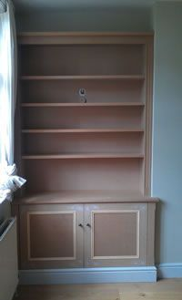 Skirting base alcove cabinet with panel mould doors