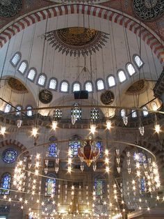 Interior of the Blue Mosque, Istanbul, Turkey. It is lit with two hundred and sixty windows which were once filled with stained glass of the seventeenth century.  Unfortunately they have been lost and replaced with replicas far more inferior.  The mosque's interior has 20,000 blue tiles that line its high ceiling. The oldest of these tiles feature flowers, trees and abstract patterns that make them fine examples of sixteenth century Iznik design. Photo: flickr.com/photos/soepvlees