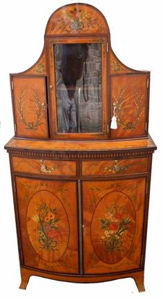 19C Satinwood Bowfront Cabinet with Fine Floral Painted Decoration.