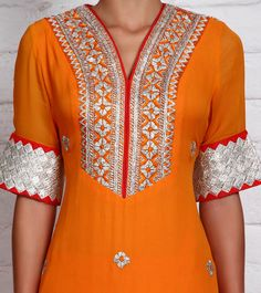 Orange Georgette Churidar Suit with Gota Work