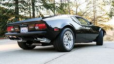 This 1972 De Tomaso Pantera is a three-owner California car showing 48k miles. The seller has owned the car for 12 years and has driven it little, and modifications include a color change to black earlier this year, an aftermarket sunroof, larger radiator, and stainless exhaust. The original 351 Cle