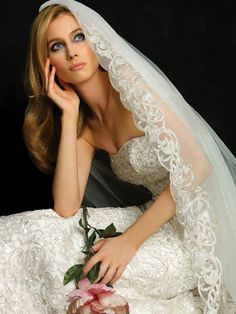 Wearing the veil at the top rather than the back of the head keeps it traditional and elegant.