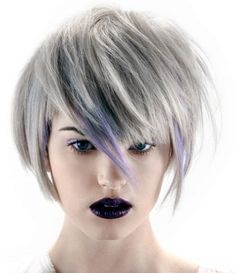 edgy short hair, platinum blond, blue highlights on edgy bangs