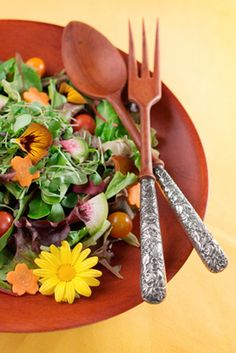I didn't know that pansies are edible.  Not sure how I feel about flowers in my salad