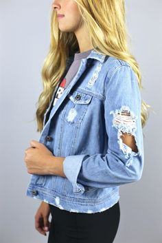 """We have searched high and low for the perfect denim jacket. We are happy to tell you we have finally found it. It has a great relaxed boyfriend fit with a soft light vintage wash and of coarse some awesome distressing. Wear it with anything and everything all year round, you are not going to want to leave home without it. Sizing is normal with a relaxed fit. Isabelle is 5'8"""" and is wearing a small."""