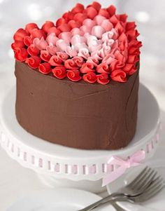 Decorate this Valentine's cake with rosebuds in five shades of red.