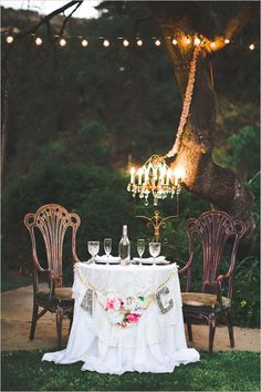sweetheart table with chandelier #sweethearttable #weddingreception #weddingchicks http://www.weddingchicks.com/2014/02/03/malibu-forest-diy-wedding/